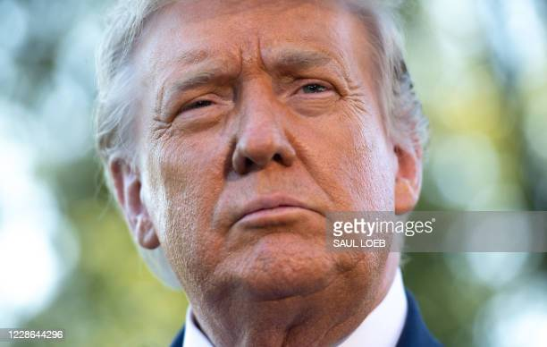 President Donald Trump speaks to the media prior to departing from the South Lawn of the White House in Washington, DC, September 21 as he travels to...