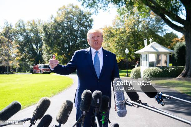 US President Donald Trump speaks to the media prior to departing on Marine One from the South Lawn of the White House in Washington DC October 23 as...
