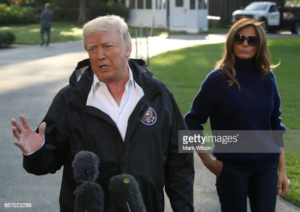 President Donald Trump speaks to the media while flanked by first lady Melania Trump before departing on Marine One from the White House on October 3...