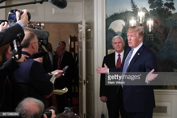 S President Donald Trump speaks to the press about the $13 trillion spending bill passed by Congress early Friday with Vice President Mike Pence in...
