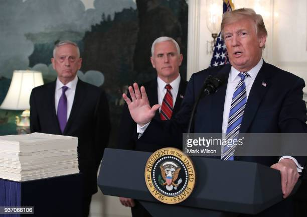 S President Donald Trump speaks to the press about the $13 trillion spending bill passed by Congress early Friday with Vice President Mike Pence and...