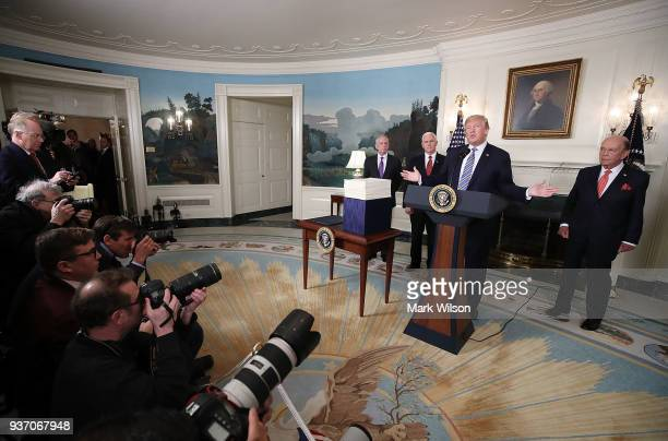 S President Donald Trump speaks to the press about the $13 trillion spending bill passed by Congress early Friday with Vice President Mike Pence...