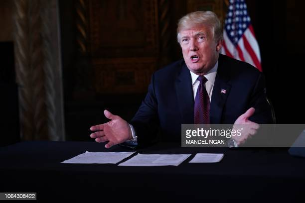 US President Donald Trump speaks to the press after talking to members of the military via teleconference from his MaraLago resort in Palm Beach...