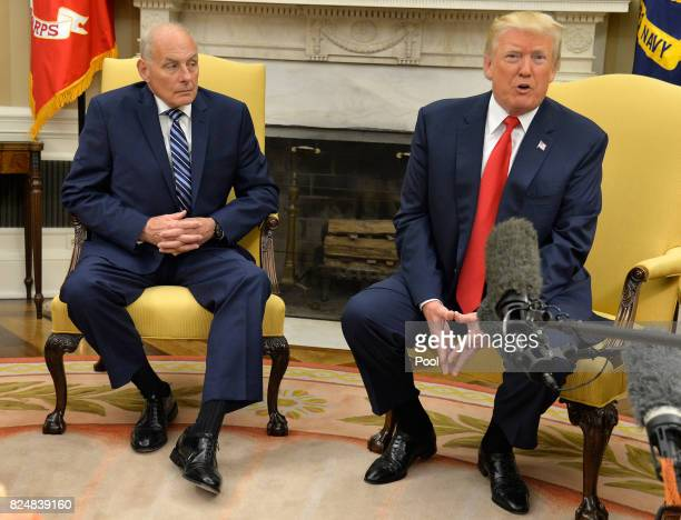 President Donald Trump speaks to the press after the new White House Chief of Staff John Kelly was sworn in in the Oval Office of the White House...