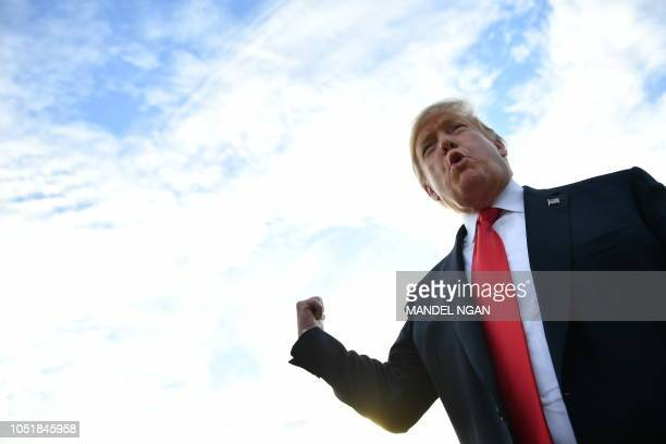 US President Donald Trump speaks to the press as he arrives at Erie International Airport on October 10 in Erie Pennsylvania for a 'Make America...