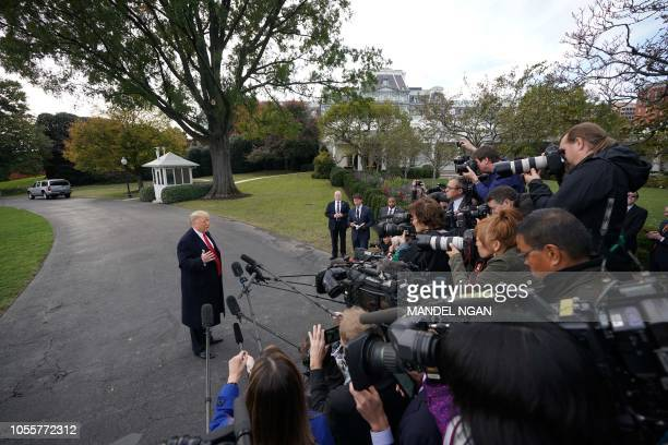 US President Donald Trump speaks to the press as he departs the White House in Washington DC on October 31 2018 Trump is traveling to Florida for a...