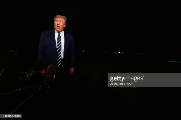 US President Donald Trump speaks to the press as he departs the White House in Washington DC on August 23 for the G7 Summit in France
