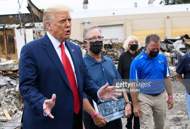 US President Donald Trump speaks to the press as he tours an area affected by civil unrest in Kenosha Wisconsin on September 1 as John Rode the...