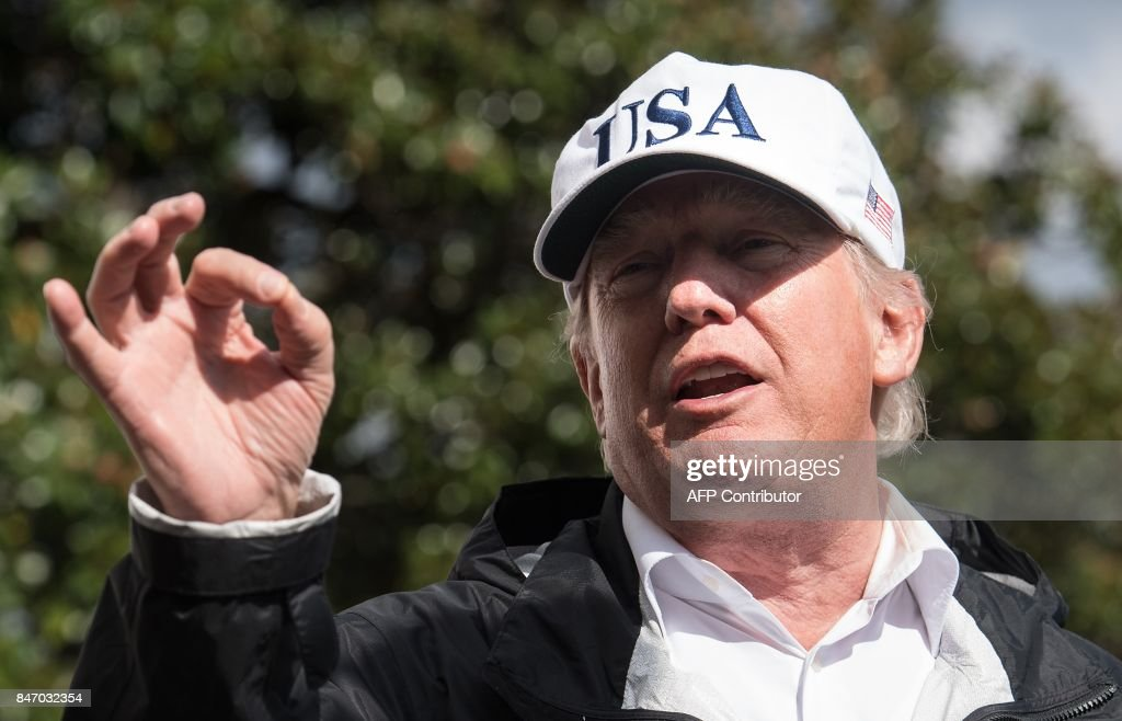 US President Donald Trump speaks to the press at the White House in Washington, DC, on September 14, 2017, upon return from Florida following Hurricane Irma. /