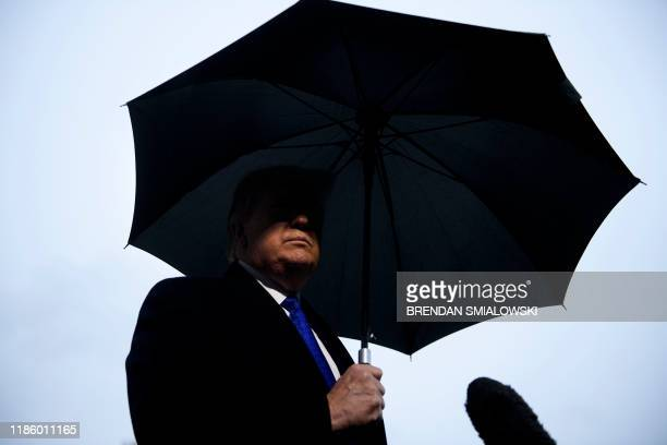 US President Donald Trump speaks to the press before departing from the White House on December 2 2019 in WashingtonDC en route to London to meet...