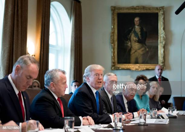 President Donald Trump speaks to the press during a Cabinet meeting at the White House on December 6, 2017 in Washington, D.C.