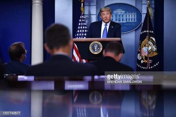 President Donald Trump speaks to the press during the renewed briefing of the Coronavirus Task Force in the Brady Briefing Room of the White House in...