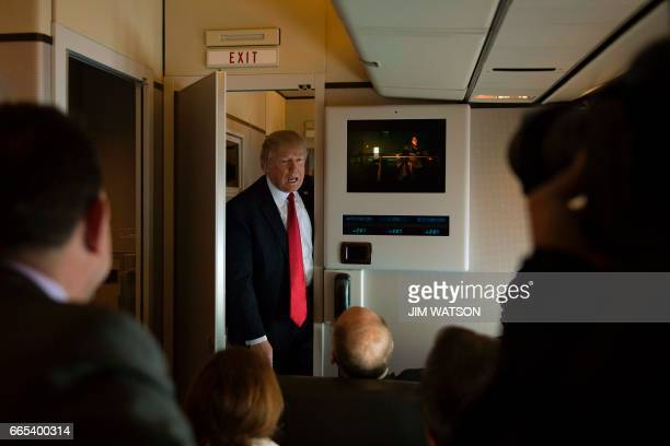 US President Donald Trump speaks to the press on Air Force One on April 6 2017 Chinese President Xi Jinping touched down in Florida Thursday for a...