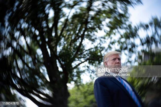 President Donald Trump speaks to the press while walking to Marine One on the South Lawn of the White House, on August 2 in Washington, DC.