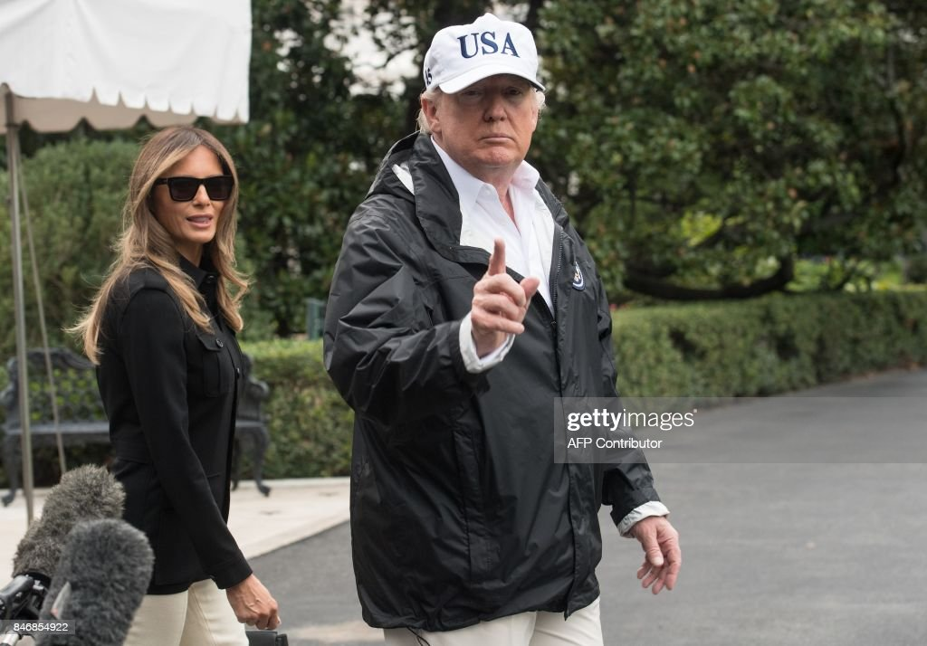 US President Donald Trump speaks to the press with First Lady Melania Trump before they depart the White House in Washington, DC, on September 14, 2017 for Florida. The Trumps will visit areas affected by Hurricane Irma. /