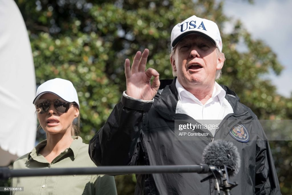 US President Donald Trump speaks to the press with First Lady Melania Trump at the White House in Washington, DC, on September 14, 2017, upon return from Florida following Hurricane Irma. /
