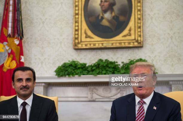 US President Donald Trump speaks to the press with the Emir of Qatar Sheikh Tamim bin Hamad alThani in the Oval Office at the White House in...