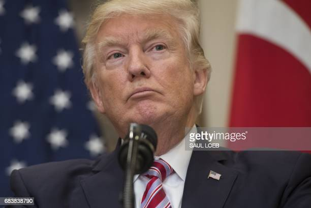 US President Donald Trump speaks to the press with Turkish President Recep Tayyip Erdogan following meetings in the Roosevelt Room of the White House...