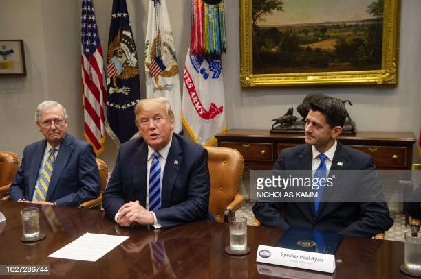 US President Donald Trump speaks to the press with US Senate Majority Leader Mitch McConnell and House Speaker Paul Ryan at the White House in...