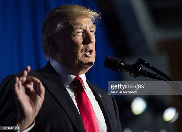 US President Donald Trump speaks to the staff at the Department of Homeland Security in Washington DC on January 25 2017 Trump vowed to restore...