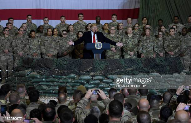 President Donald Trump speaks to the troops during a surprise Thanksgiving day visit at Bagram Air Field on November 28 2019 in Afghanistan