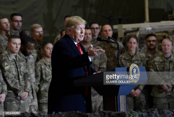 US President Donald Trump speaks to the troops during a surprise Thanksgiving day visit at Bagram Air Field on November 28 2019 in Afghanistan