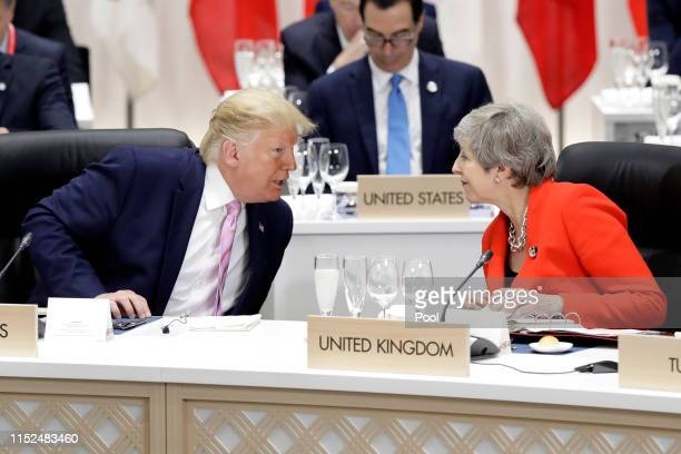 President Donald Trump , speaks to Theresa May, U.K. Prime minister, prior to a working lunch on the first day of the G20 summit on June 28, 2019 in...
