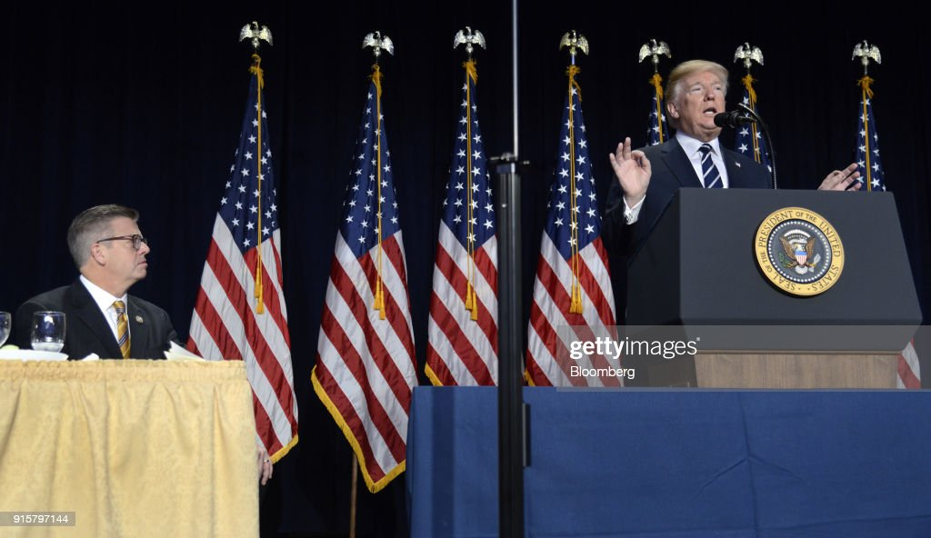 U.S. President Donald Trump speaks while as Representative Randy Hultgren, a Republican for Illinois, left, listens during the National Prayer Breakfast in Washington, D.C., U.S., on Thursday, Feb. 8, 2018. Trump urged a more just and peaceful world, praised the military and U.S. advances in fighting Islamic State and reiterates support for oppressed people in Iran and North Korea. Photographer: Mike Theiler/Pool via Bloomberg