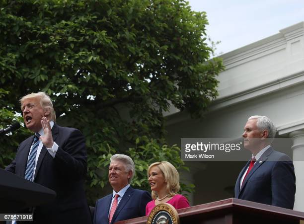S President Donald Trump speaks while by Vice President Mike Pence Pastor Paula White and Pastor Jack Graham during a National Day of Prayer event in...