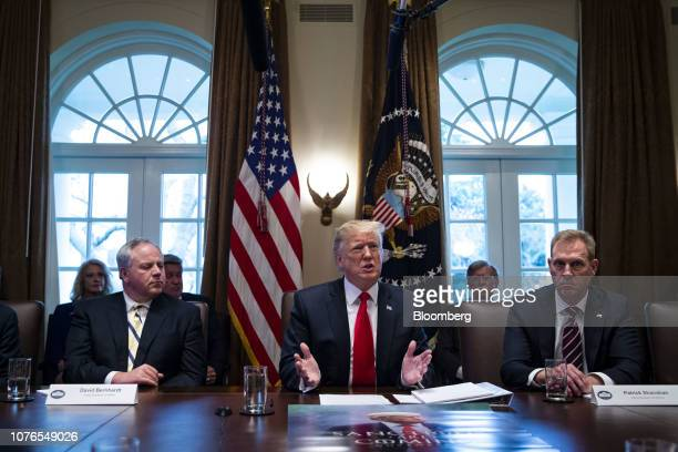 US President Donald Trump speaks while David Bernhardt acting US secretary of interior left and Patrick Shanahan acting US secretary of defense right...
