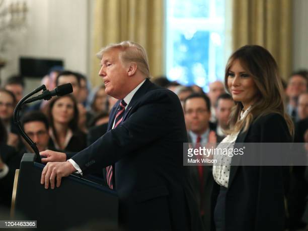 S President Donald Trump speaks while flanked by first lady Melania Trump one day after the US Senate acquitted him on two articles of impeachment in...