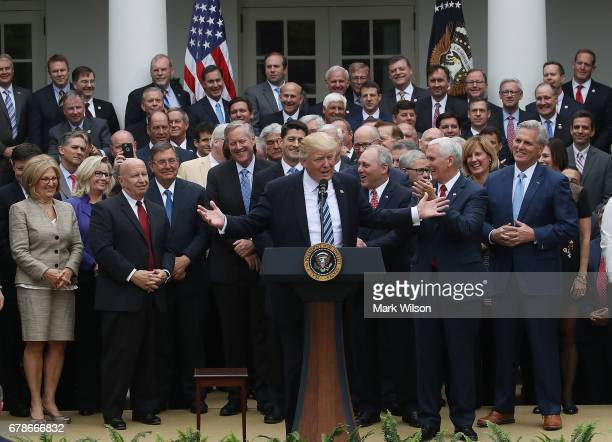 S President Donald Trump speaks while flanked by House Republicans after they passed legislation aimed at repealing and replacing ObamaCare during an...