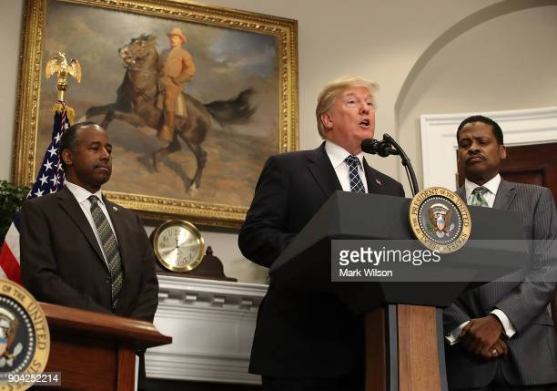 S President Donald Trump speaks while flanked by HUD Secretary Dr Ben Carson and Isaac Newton Farris Jr before signing a proclamation to honor Martin...