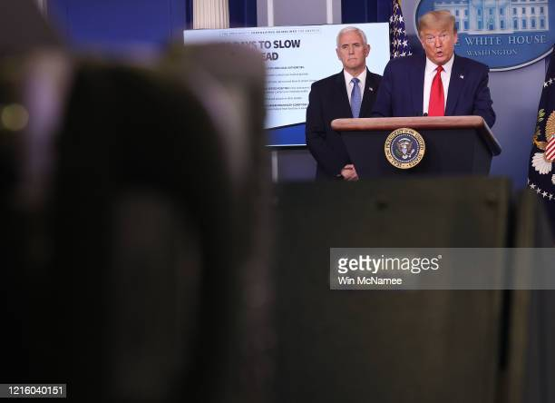 S President Donald Trump speaks while flanked by Vice President Mike Pence during the daily coronavirus task force briefing in the Brady Briefing...