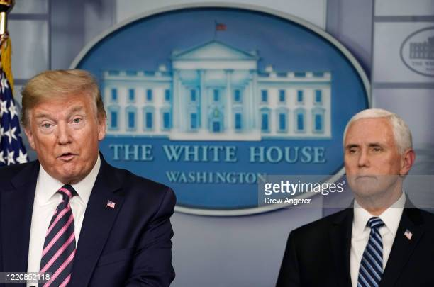 S President Donald Trump speaks while flanked by Vice President Mike Pence during the daily coronavirus task force briefing at the White House on...