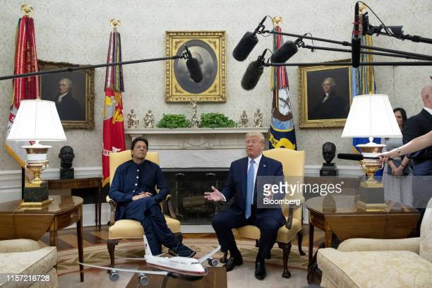 President Donald Trump speaks while Imran Khan, Pakistan's prime minister, left, listens during a meeting in the Oval Office of the White House in...