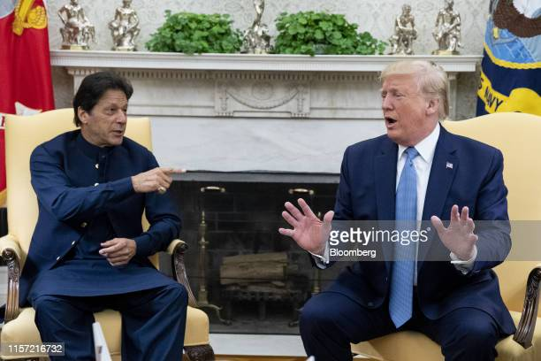 President Donald Trump speaks while Imran Khan, Pakistan's prime minister, left, gestures during a meeting in the Oval Office of the White House in...
