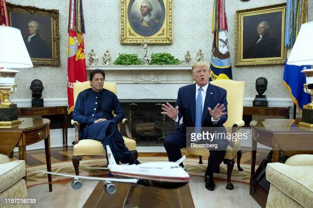 US President Donald Trump speaks while Imran Khan Pakistan's prime minister left listens during a meeting in the Oval Office of the White House in...