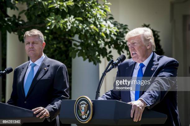 US President Donald Trump speaks while Klaus Iohannis Romania's president left listens during a joint press conference in the Rose Garden of the...