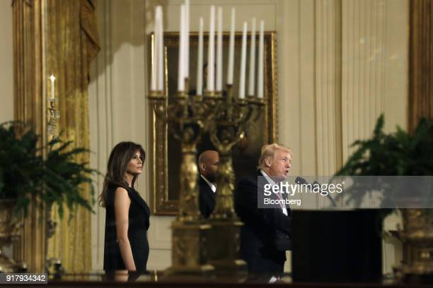 US President Donald Trump speaks while US First Lady Melania Trump left listens during a National African American History Month reception in...
