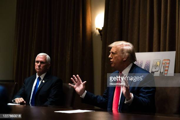 US President Donald Trump speaks while Vice President Mike Pence left listens during a meeting with leadership from the National Association of...