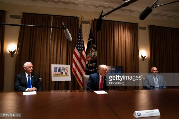 US President Donald Trump speaks while Vice President Mike Pence left and John Kazanjian president of the Palm Beach County Florida Police Benevolent...
