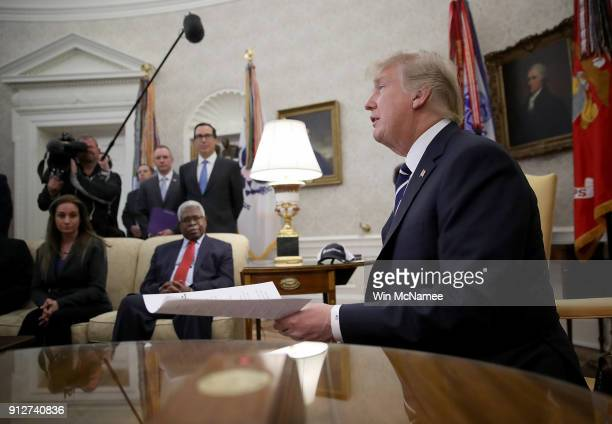 S President Donald Trump speaks with American workers in the Oval Office about the recently passed tax reform package on January 31 2018 in...