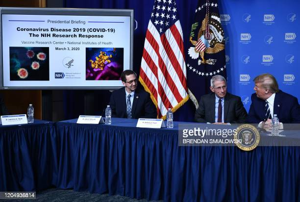 US President Donald Trump speaks with Anthony Fauci director of the NIH National Institute of Allergy and Infectious Diseases as John Mascola...