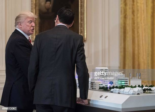 US President Donald Trump speaks with ATT Ceo Randall Stephenson as he explains how 5G networks will be deployed during an American Leadership in...