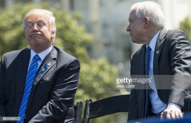 President Donald Trump speaks with Attorney General Jeff Sessions during the 36th Annual National Peace Officers Memorial Service at the US Capitol...