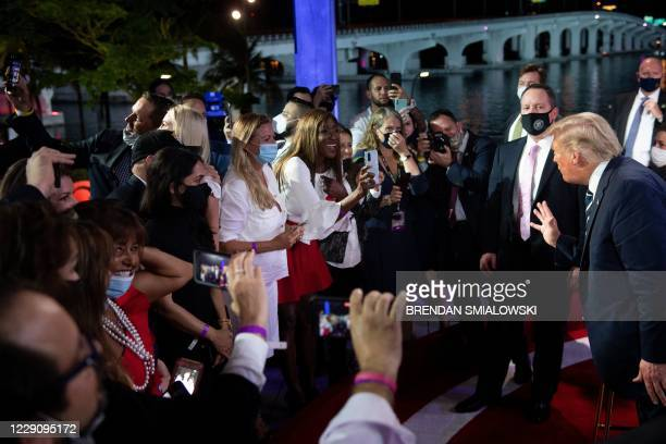 President Donald Trump speaks with audience members after participating in an NBC News town hall event at the Perez Art Museum in Miami on October...