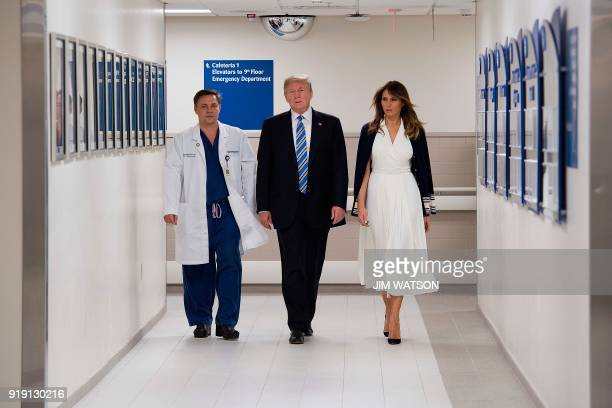 US President Donald Trump speaks with doctor Igor Nichiporenko and First Lady Melania Trump while visiting first responders at Broward Health North...
