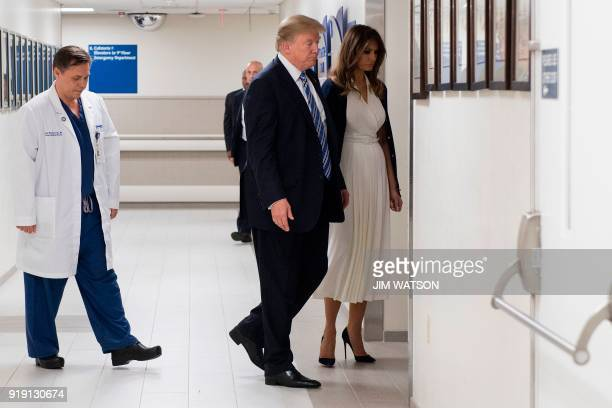 President Donald Trump speaks with doctor Igor Nichiporenko and First Lady Melania Trump while visiting first responders at Broward Health North...