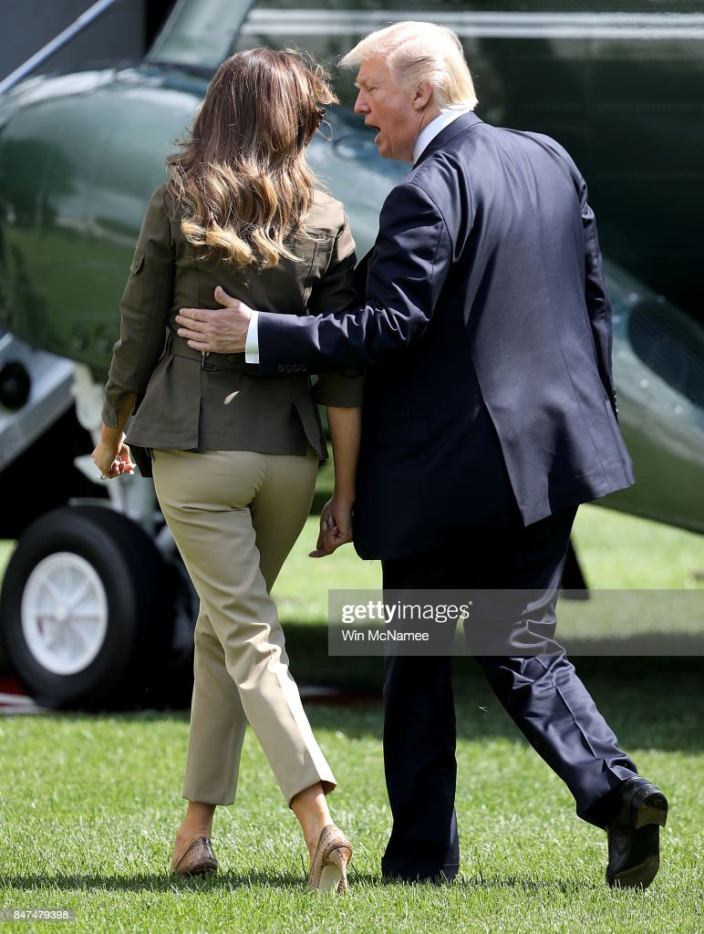 U.S. President Donald Trump speaks with first lady Melania Trump as they depart the White House on September 15, 2017 in Washington, DC. Trump is scheduled to spend the weekend in New Jersey and next week in New York City attending the United Nations General Assembly.